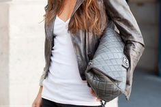 Distressed cropped leather biker jacket set off by quilted Chanel...nice play