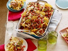 Recipe of the Day: Ree's Cowboy Nachos         Now that football season's in full swing, your nacho game should be taken extra seriously. Follow Ree's lead and pile tortilla chips high with spicy beans, cheese and pico de gallo, not to mention marinated braised brisket. Broiling it all in the oven will have the cheese on these nachos stringing from the plate to your mouth.