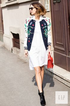 Layer jackets over dresses this season for a perfect spring look. Milan-based editor Candela Novembre heads out in her Gap white shirtdress and a cool bomber jacket. Shop all new dresses now.