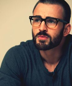it doesn't matter what @Laura McFarlane says, i like him with a beard. & those glasses are ballin