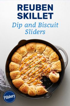 This cheesy, corned beef skillet dip is baked with stuffed-biscuit sliders for an appetizer that has all the classic flavors of a Reuben sandwich and is guaranteed to please your hungry guests on game day. Appetizer Dips, Appetizer Recipes, Dip Recipes, Cooking Recipes, Recipies, Good Food, Yummy Food, Football Food, Reuben Sandwich