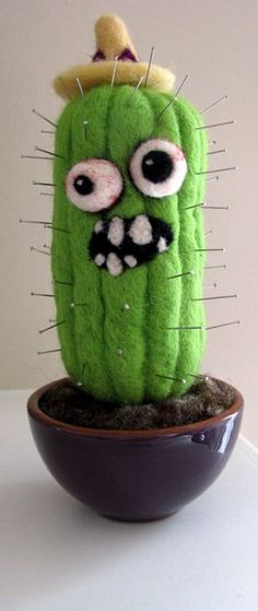 amorningcupofjo:    Zombie cactus pincushion.   Clever idea, SheWhoStamps, clever.  (Handmade: needle felted.)