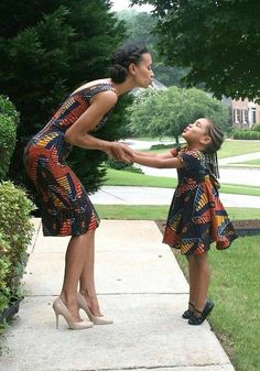 this is so cute woman looking like a mom a girl looking like a little girl/daughter