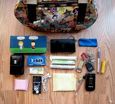 Made Flickr's Explore  Highest Position: 213/500    Highly recommend that you VIEW LARGE    I've wanted to photograph the contents of my purse and participate in the What's In Your Bag? group for a while now. I finally had a chance to do it today :)       Click on the image for more info.  http://www.woodenpurses.com