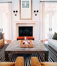 We love the simplicity of this mantel, and the symmetry of the sitting area. - Traditional Home ® / Photo: Patrick Cline / Design: Lauren Gold and Sasha Adler