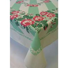 Cotton tablecloths with prints like this - my Grandmother used to iron and starch hers!