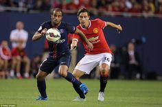 Manchester United new boy Matteo Darmian chases down PSG's Brazil international Lucas Mour...