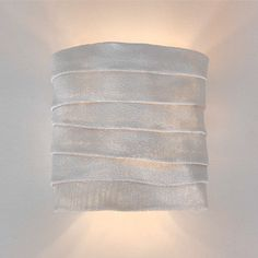 The Arturo Alvarez Kala Wall Lamp design is inspired by the patterns left from the wind at the great dunes. Crafted by SIMTECH, a steel mesh covered … Wall Sconce Lighting, Wall Sconces, Lamp Design, Lighting Design, House Lamp, Wall Lights, Ceiling Lights, Stainless Steel Mesh, How To Make Light