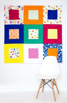 Make this easy picnic quilt using simple instructions that guide you through constructing the square within a square block that make up this quilt.
