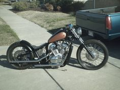 Honda Shadow VT600 hardtail custom with wide low profile rear tire and long drag pipes