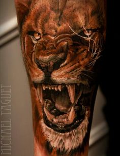 Michael taguet lion tattoo