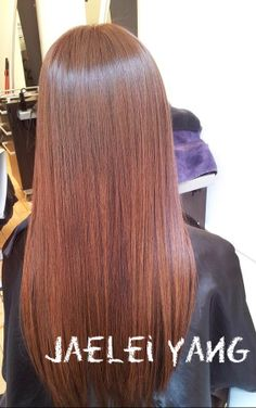 Beautiful shiny redhead copper on Asian hair.