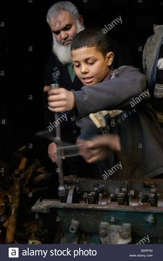 Thirteen year old Ahmed works every day in car repair place to Stock Photo, Royalty Free Image: 18956476 - Alamy