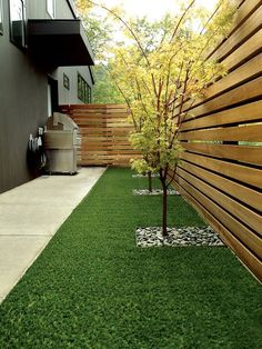 backyard privacy fence wood trees grill area