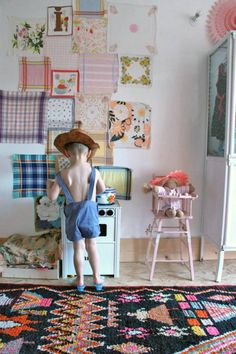 Decorating the kid's room wall with fabric remnants - what a beautiful idea!