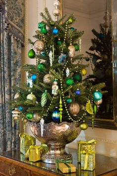 I think small accenting table trees are beautiful. I very much like the silver punch bowl for the base of the tree. sweet.