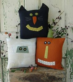 Halloween pillows~ a cute variation of these would be to use tee-shirts OR for kids - stuffed decorated butcher paper.  Cute!