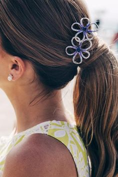 A chic floral touch to your spring/summer ponytail looks! #springhair