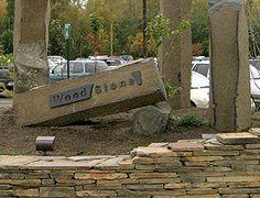 cast bronze signage installed on stone