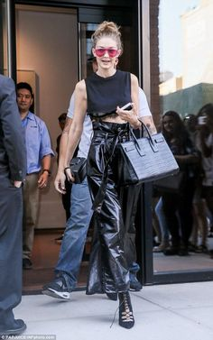 Gigi Hadid wearing Saint Laurent Classic Sac De Jour Leather Tote, Mirina Collections Dash Sunglasses and Stuart Weitzman Black Suede Dramaqueen Booties