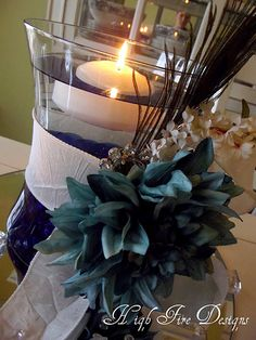Reception centerpiece with peacock feather accent by High Fire Designs