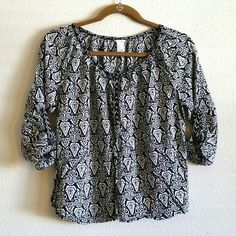 Forever21 batik tribal print blue & white blouse F21 navy blue & white bohemian tribal batik print blouse top, size small. Great condition, never worn. Breezy, flowy fabric. Brass buttons on sleeves and a few inches down front. Sleeves have button-up tabs inside. Forever 21 Tops Blouses