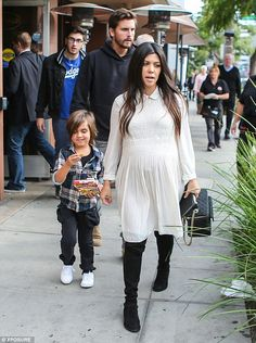Smock and boots: Kourtney Kardashian looked stylish in a white collared dress and knee-length boots after lunch in Beverly Hills with Scott Disick and son Mason on Thursday