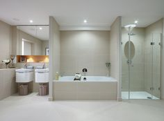 A vast bathroom including a shower and two sinks, modern design with the practicalities of daily use in mind