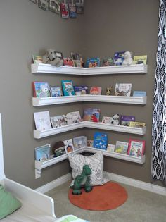 Rain Gutters used as a floating bookshelf! Inexpensive & quick, plus its a great way to save space & keep child's room organized!