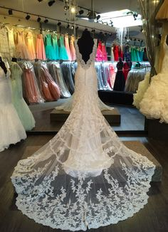 #Allure Bridals lowback, lace wedding dress. Dramatic wedding dress with very long lace train. Deep back and romantic wedding gown. #9304