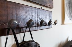 A repurposed coat rack, using old golf clubs and a wood plank from a local antique store.