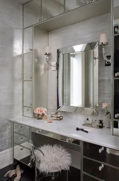 Mirrored vanity station with fur stool via Wendy Labrum Interiors If you're looking for a makeup table or bedroom vanity, then consider these twelve ultra-galmorous vanities with white or mirrored sides! Sala Glam, Make Up Tisch, Vanity Room, Bedroom Vanities, Vanity Cabinet, Glam Room, Makeup Rooms, Room Closet, Makeup Storage