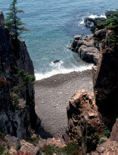 The Schoodic Peninsula is a peninsula in Down East Maine. It is located four miles east of Bar Harbor, Maine, as the crow flies. The Schoodic Peninsula contains 2,266 acres, or approximately 5%, of Acadia National Park.