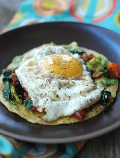 Breakfast Tostada Recipe - I used Bacon instead of sausage and scrambled eggs instead of fried.
