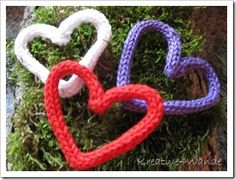 French knitting hearts. couldn't be heard to make? Pipe cleaners inside? Would make cute christmas tree decorations...