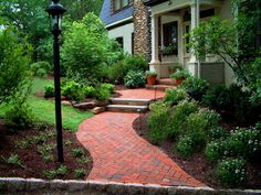 This new curved walkway was integrated into  the landscape for a Tudor home. Although it looks like brick, it is actually pavers. Solid bluestone tread were used...bluestone and brick go great together. Many of the older plants plants remained while new plants were added. http://www.landscape-design-advice.com/front-yard-landscaping-ideas.html