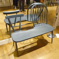 Odd Couple Bench by Plant & Moss. It is handmade in Britain using traditional wood turning and steam bending skills.