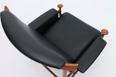 The unique design of a The Bwana chair in teak and leather. Designed by Finn Juhl and manufactured by France & France, Denmark. www.reModern.dk