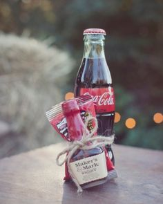 have a drink on me - from bride to groomsmen. I like the classic coke bottle. This could be done with a bottle of Jack Daniels too.