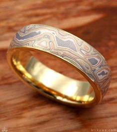 Layers of 18k yellow gold, 14k white gold, 14k rose gold and sterling make up this warm mokume gane flavor! Check out Krikawa's seven other mokume gane flavors to design your unique wedding or engagement ring with!