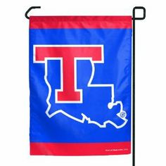 """NCAA Louisiana Tech Bulldogs Garden Flag by WinCraft. $11.45. Indoor or outdoor use. Made in USA. Perfect for the #1 fan. Machine Washable. Decorated with full color graphics. Officially licensed garden flag. Durable polyester flag measures 11"""" x 15"""". Machine washable. Designed to hang vertically from a garden flag pole or inside as wall decor. Made in USA."""