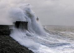 The lighthouse in Porthcawl on the South Wales coast getting swallowed by the waves.  Though many lighthouses today are unmanned, people still need to check on the machinery once in a while, especially the lamps, but in most locations, there's no need for anyone living in a lighthouse year-round