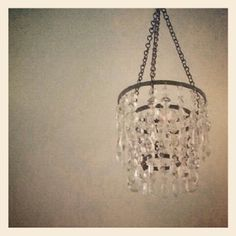 Small crystal chandelier hanging in layla's room, was meant to hold a candle but now just reflects sunlight...reused from my old apartment