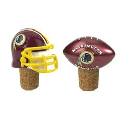"""Set of 2 NFL Washington Redskins Wine Bottle Cork Stoppers by CC Sports Decor. $29.99. Washington Redskins 2-Piece Bottle Cork SetItem #10648Officially licensed merchandiseKeep your wine fresh and show off your team spiritFeatures two corks with a replica of your favorite team's official helmet, and a football with the team logoDimensions: 2.25""""HMaterial(s): cork/resin"""