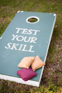 bean bag toss for outdoor wedding, something for guests to do while the wedding party is taking pictures