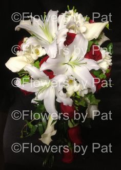 the cascade is still in style for many modern brides.  White oriental lilies, white miniature calla lilies, white freesia and red roses with English Ivy and Italian Ruscus are great choices for your red and white wedding. IMG_2012_wm by Flowers by Pat, via Flickr  visit us at: www.flowersbypat.com for more wedding ideas