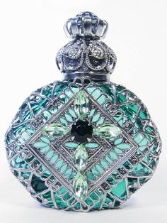 (via Beautiful Glass / Mouth-blown glass perfume bottle handmade in the Czech Republic by a 200-year-old family-run business.)