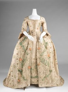 Very pretty sack back gown with lots of trim.  It now closes in the center front.  I can't tell if this has been altered from an earlier style.  Met Museum ca. 1775.