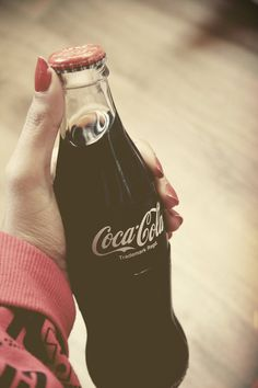 Red polish holding a Coke in a glass bottle. YESSss!