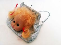 Vintage purse with doll head. €35.00, via Etsy.